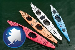 alaska map icon and four colorful fiberglass kayaks