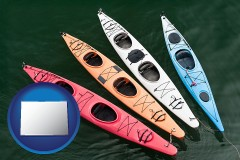 colorado map icon and four colorful fiberglass kayaks