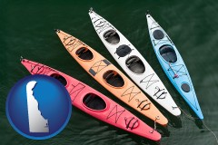 delaware map icon and four colorful fiberglass kayaks