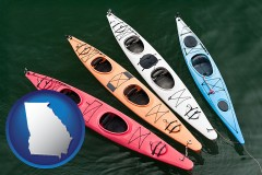 georgia four colorful fiberglass kayaks