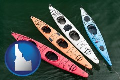 idaho map icon and four colorful fiberglass kayaks