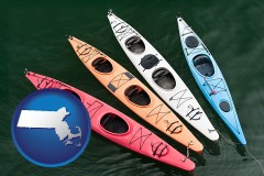 massachusetts map icon and four colorful fiberglass kayaks