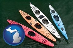 michigan map icon and four colorful fiberglass kayaks