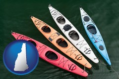 new-hampshire map icon and four colorful fiberglass kayaks
