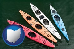 ohio map icon and four colorful fiberglass kayaks