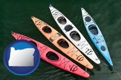 oregon map icon and four colorful fiberglass kayaks