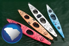 south-carolina map icon and four colorful fiberglass kayaks