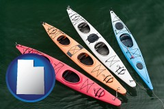 utah map icon and four colorful fiberglass kayaks