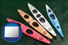 wyoming map icon and four colorful fiberglass kayaks