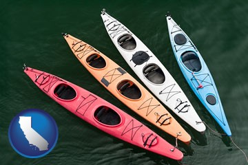 four colorful fiberglass kayaks - with California icon