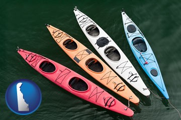 four colorful fiberglass kayaks - with Delaware icon