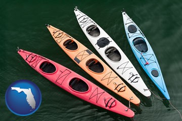 four colorful fiberglass kayaks - with Florida icon