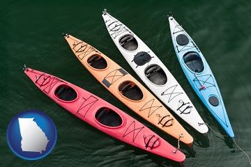 four colorful fiberglass kayaks - with Georgia icon