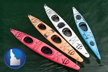 four colorful fiberglass kayaks - with Idaho icon