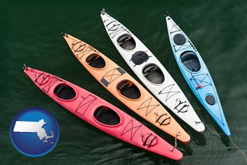 four colorful fiberglass kayaks - with Massachusetts icon