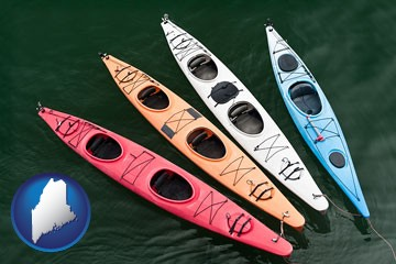 four colorful fiberglass kayaks - with Maine icon