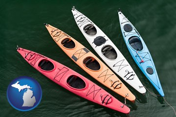 four colorful fiberglass kayaks - with Michigan icon