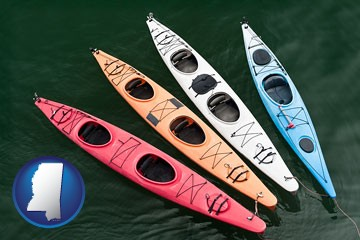 four colorful fiberglass kayaks - with Mississippi icon