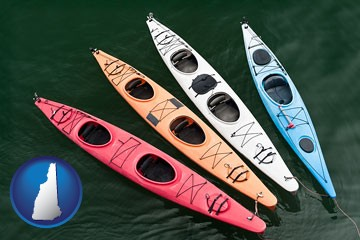 four colorful fiberglass kayaks - with New Hampshire icon