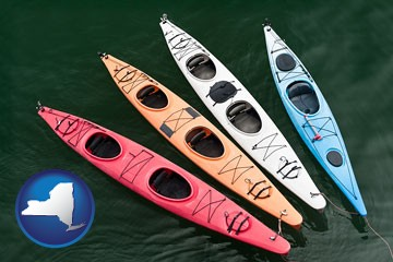 four colorful fiberglass kayaks - with New York icon
