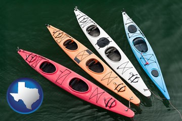 four colorful fiberglass kayaks - with Texas icon