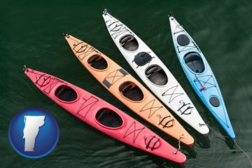 four colorful fiberglass kayaks - with Vermont icon