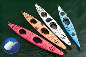 four colorful fiberglass kayaks - with West Virginia icon
